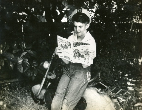 boy reading superman